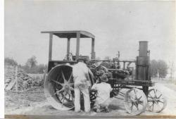 Family History Photo of the Week Winner (3 June 2016):  J C Harris (kneeling) and his 1914 Tractor