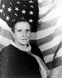Portrait of Gertrude Stein, with American flag as backdrop (1935 January 4)