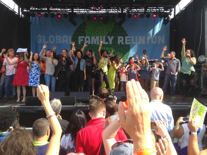 A shot of the main stage at the Global Family Reunion with Sister Sledge, AJ Jacobs and his family and a cast of thousands singing WE ARE FAMILY!