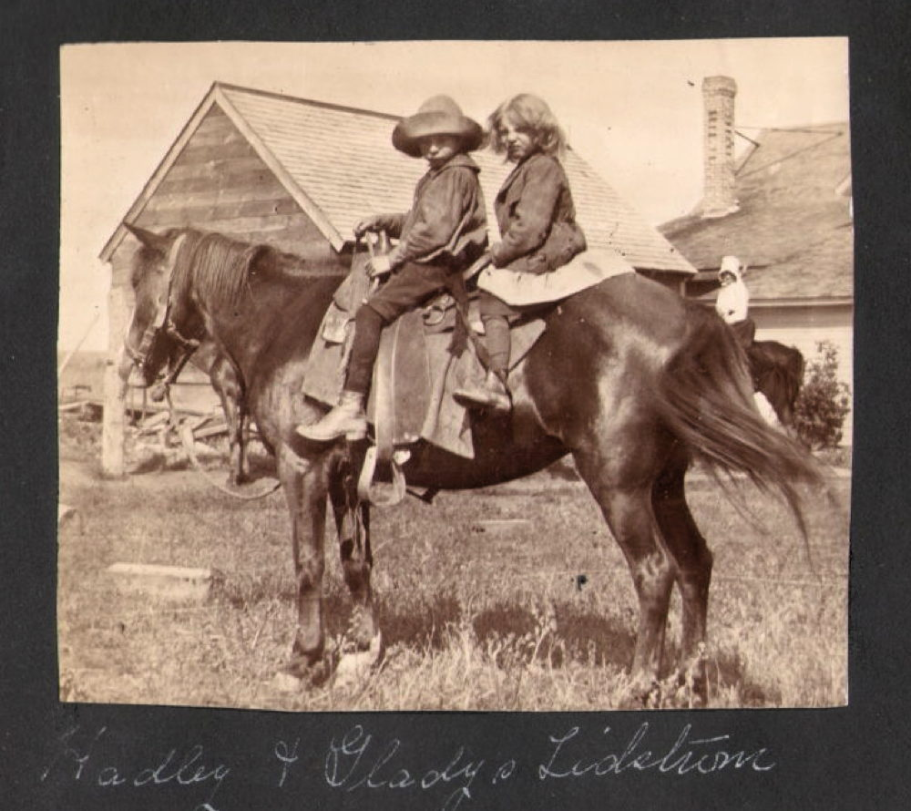 Brother and sister on horse, about 1902