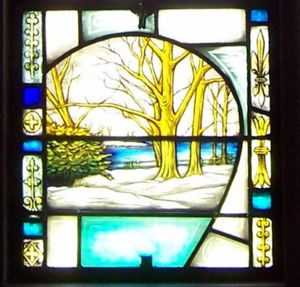 Stained glass church window depicting land Elizabeth owned