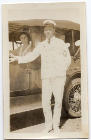 Elmer Bruce Lloyd, standing, and Sissy, at wheel of car