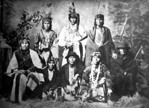 Hočąk Chiefs. Left to Right: Back Row (Standing): Little Creek, Winneshiek, Judge; Front Row (Seated and Kneeling): Blue Wing, Decorah (Wąkąhaga ?), Yellow Thunder, George Goodvillage, K[Writing Cut Off]. Photo by Jones.