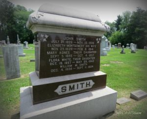 Gravestone for John Smith and Family