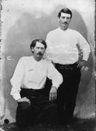 Bat Masterson (standing) and Wyatt Earp in Dodge City, 1876