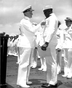 Miller receiving the Navy Cross from Admiral Nimitz.