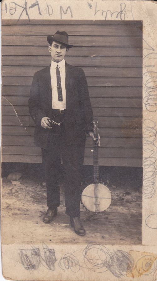 My grandmother's step-brother, Edward Starling (Herrage) Davidson. Not sure why he needs the gun - to protect his banjo, perhaps??