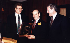 James Sirmons (middle) with Howard Stringer (left) and Dan Rather (right)