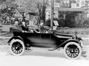 John and Horace Dodge Riding in the Back of their First Production Model Car