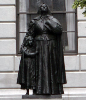 Statue of Anne Hutchinson with her daughter, Susanna, by Cyrus Dallin unveiled in 1915 (dedicated in 1922)