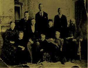 R to L - Back Row: (Standing) - Louis (Lou) -Blacksmith & Mechanic /  John ( Jack ) - Mechanic / William (Will) - Teacher, Evangelist, Future Premier of Alberta. Middle Row ( Seated)Mrs. Louisa Aberhart ( nee Pepper ) / Charles ( Charlie ) - Druggist / Au